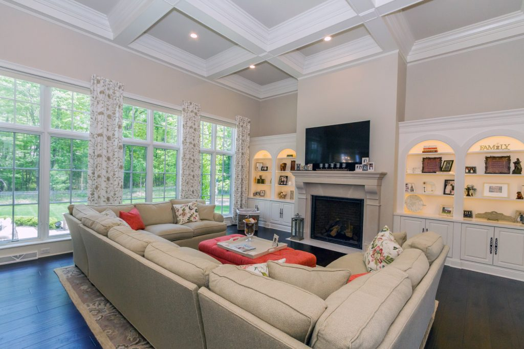 20 Rose Terrace is a luxury home for sale in Saratoga Springs, NY with coffered ceiling, hardwood floors, built-in cabinets and four gas fireplaces