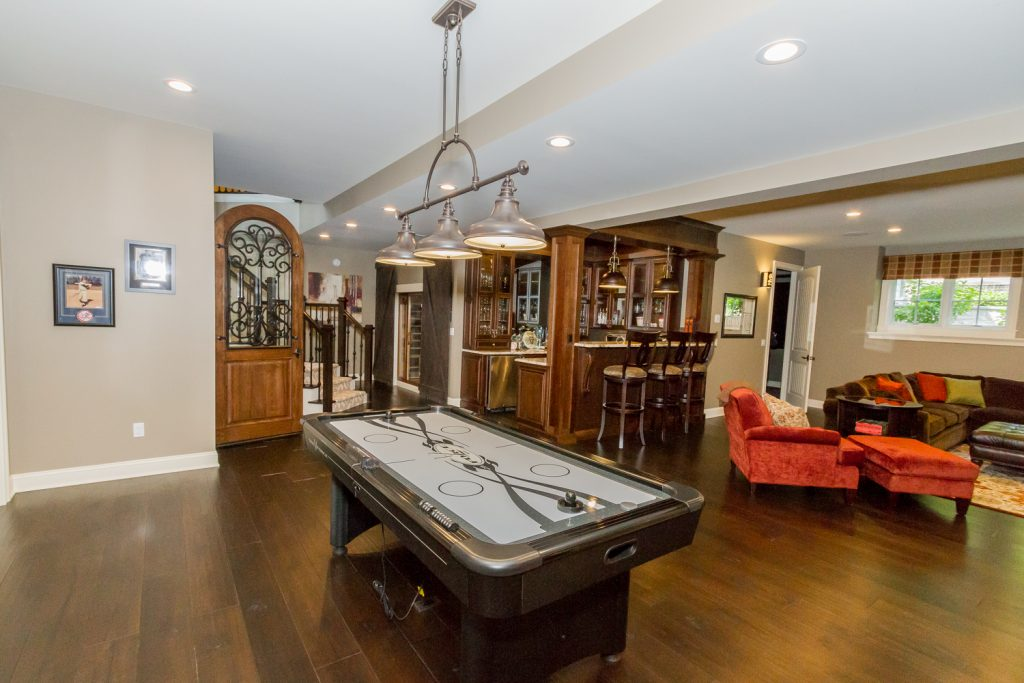 20 Rose Terrace is a luxury home for sale in Saratoga Springs, NY with a finished basement featuring a kitchenette, wine cellar, home theater and exercise room