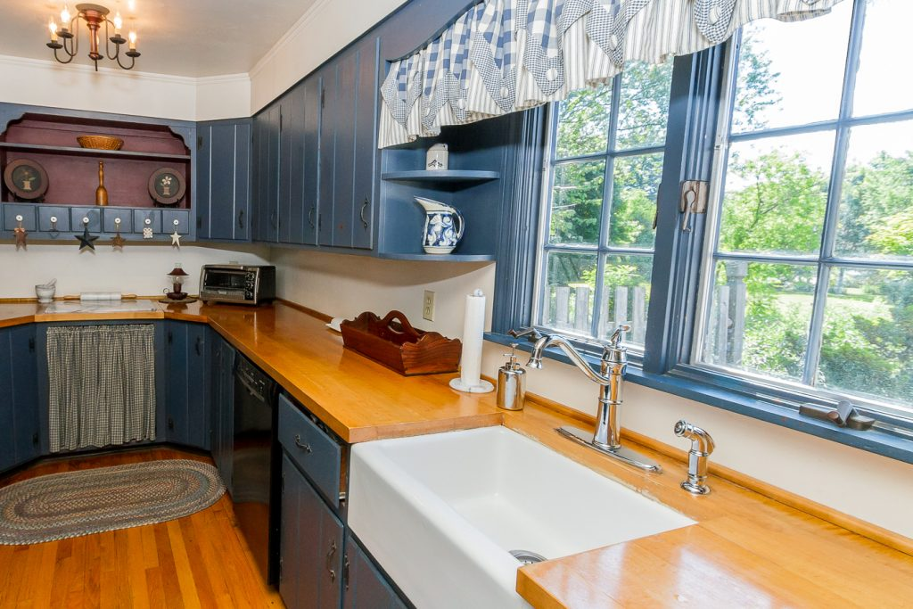 763 Charlton Road in Charlton, NY is a historic home for sale with a galley kitchen with solid countertops and a farm sink