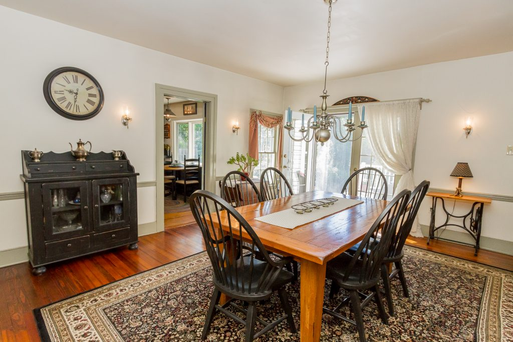 763 Charlton Road in Charlton, NY is a historic home for sale with a large formal dining room with hardwood floors and french doors