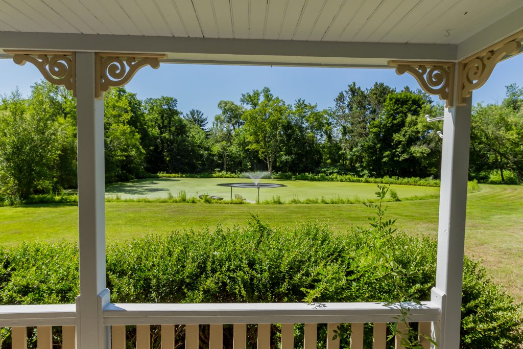 763 Charlton Road in Charlton, NY is a historic home for sale with a beautiful guest cottage that overlooks a private pond