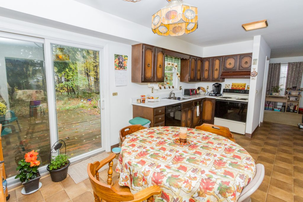 4 Anyhow Lane is a home for sale in Wilton, NY with an eat in kitchen with sliding door leading to back patio