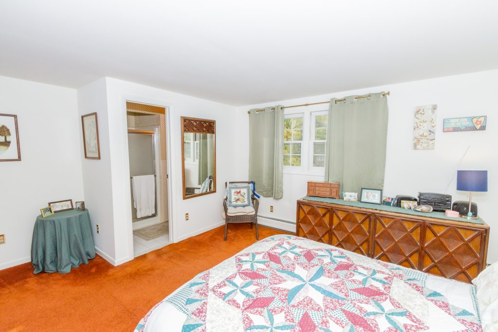 4 Anyhow Lane is a home for sale in Wilton, NY that has a spacious master suite with carpet flooring