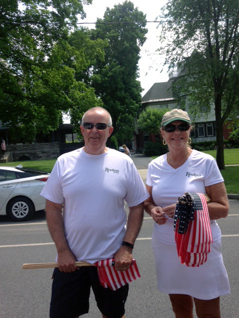 Tom Roohan and Mara King help distribute thousands of American Flags downtown for the 2017 Flag Day Parade - an annual tradition that Roohan Realty has proudly sponsored for decades.
