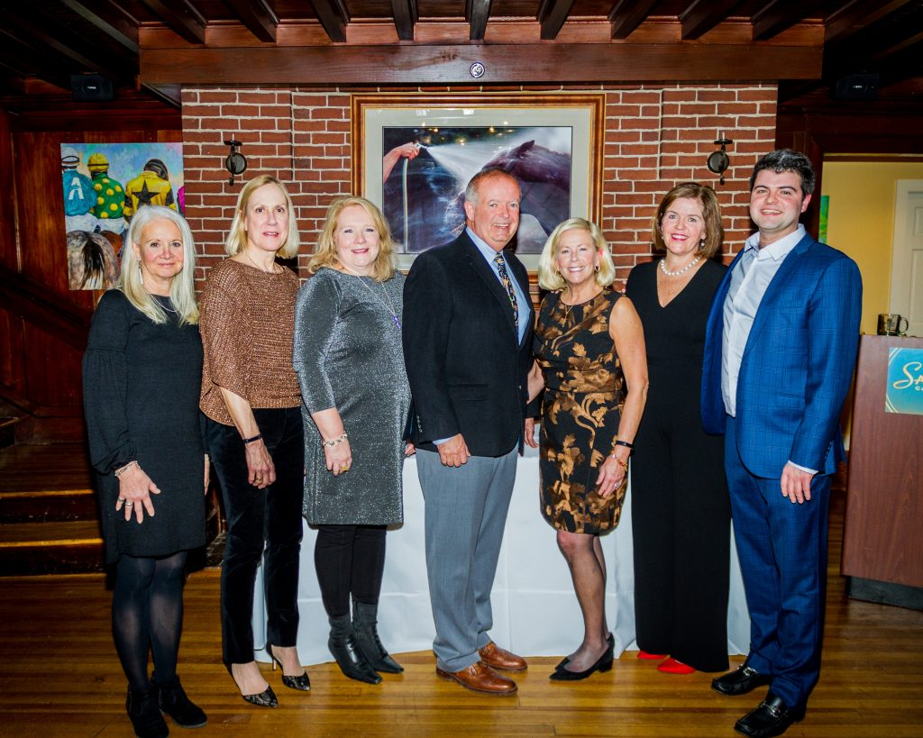 "Tom with Roohan Realty's top agents of 2018 (from left to right): Darlene Chorman, Margaret ""Meg"" Minehan, Valerie Thompson, Tom Roohan, Amy Sutton, Kate R. Naughton and Conner Roohan"