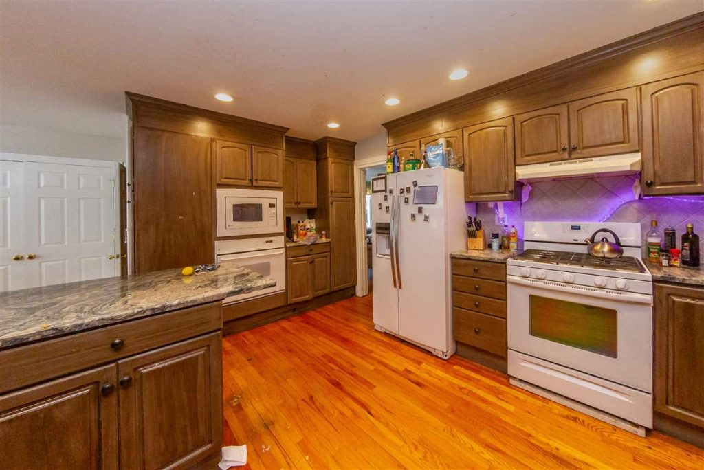 138 Nelson Avenue NY 12866 is a home for sale with a Large open kitchen with plenty of storage and beautiful granite counter tops.