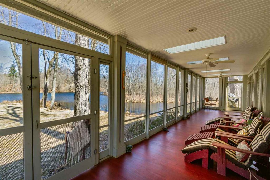 133 Brown Point Lane Saratoga Springs NY - Large, wraparound screened porch overlooking the home's private waterfront view of Fish Creek