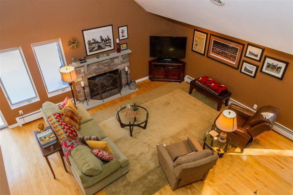 321 Ruggles Road is a home for sale in Wilton, NY with a large open living room with wood-burning fireplace