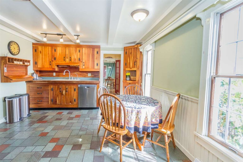 112 North Milton Road in Greenfield NY is a home for sale with a country kitchen with new stainless appliances, handmade cherry cabinets and wood stove