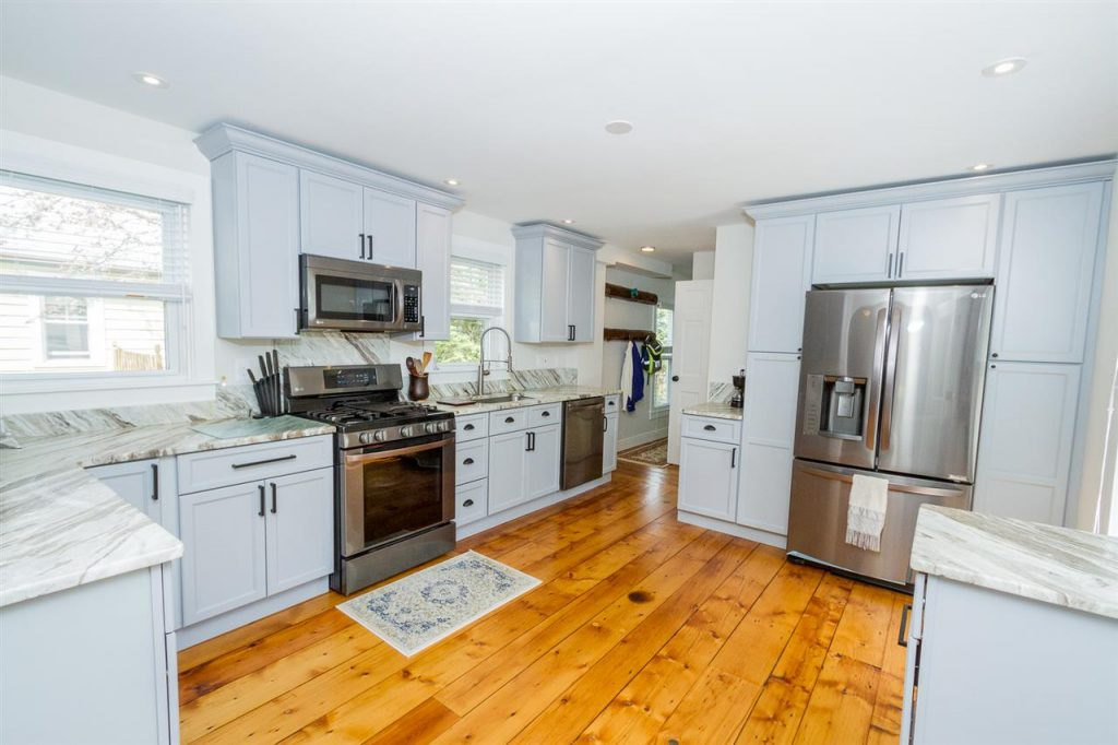 189 Lake Avenue has an Impeccably renovated kitchen with brand new weathered natural stone counters and stainless steel appliances