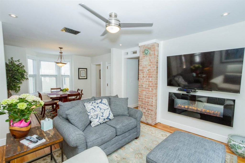 189 Lake Avenue has a spacious living/dining room with bay window and exposed brick