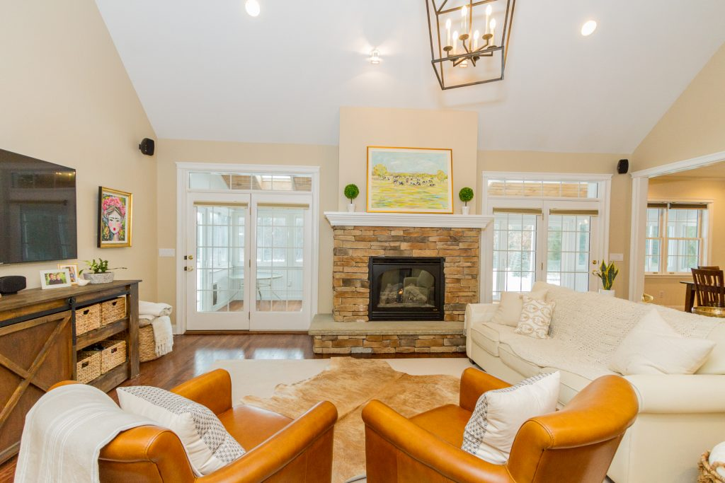 213 Kaydeross Avenue East is a home for sale in Saratoga Springs, NY with a Classic stone fireplace with accent wood mantle & vaulted ceilings