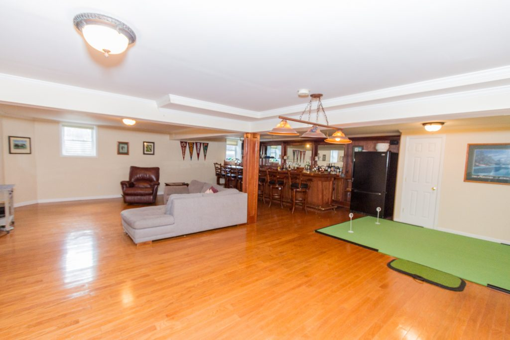 213 Kaydeross Avenue East is a home in Saratoga Springs, NY with a Extremely spacious finished lower level with full length bar + sink, dishwasher, fridge & full bath. Radiant floors. Bose surround sound system and TV system.