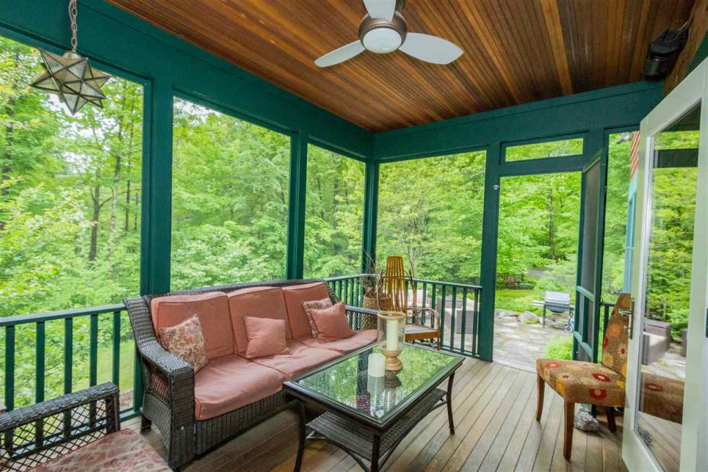 Mahogany screened porch leading to a beautiful blue stone patio