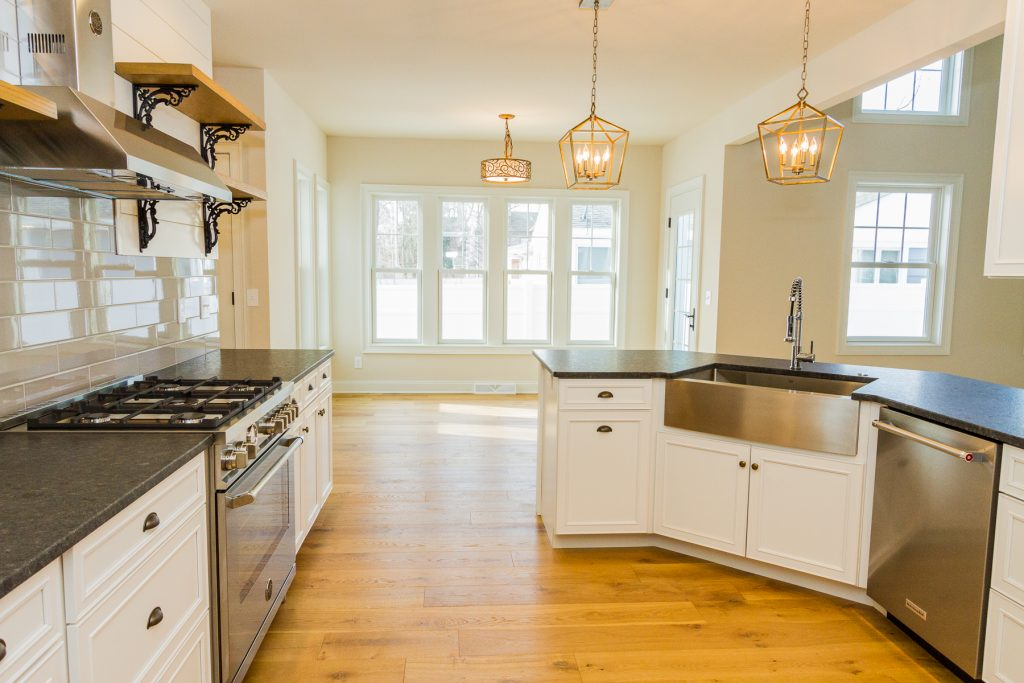 7 Madison Street, Saratoga Springs, NY is a new construction home for sale with a Gourmet kitchen outfitted with ENERGY STAR stainless steel appliances, Bertazzoni gas range and leathered granite counter tops