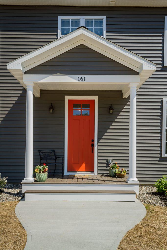 Red statement door at 161 Burgoyne Road