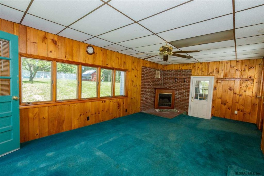 40 Fuller Road, Corinth, NY 12822 is a home for sale with knotty pine family room and gas fireplace