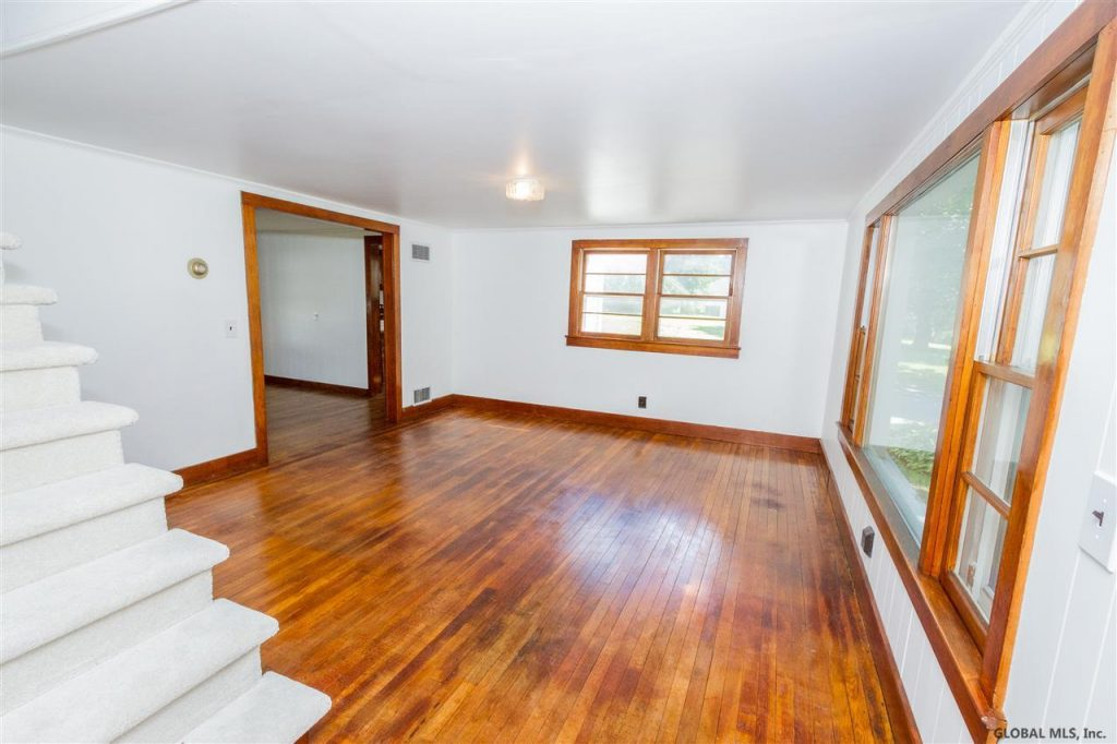 40 Fuller Road, Corinth, NY 12822 is a home for sale with freshly stained hardwood floors