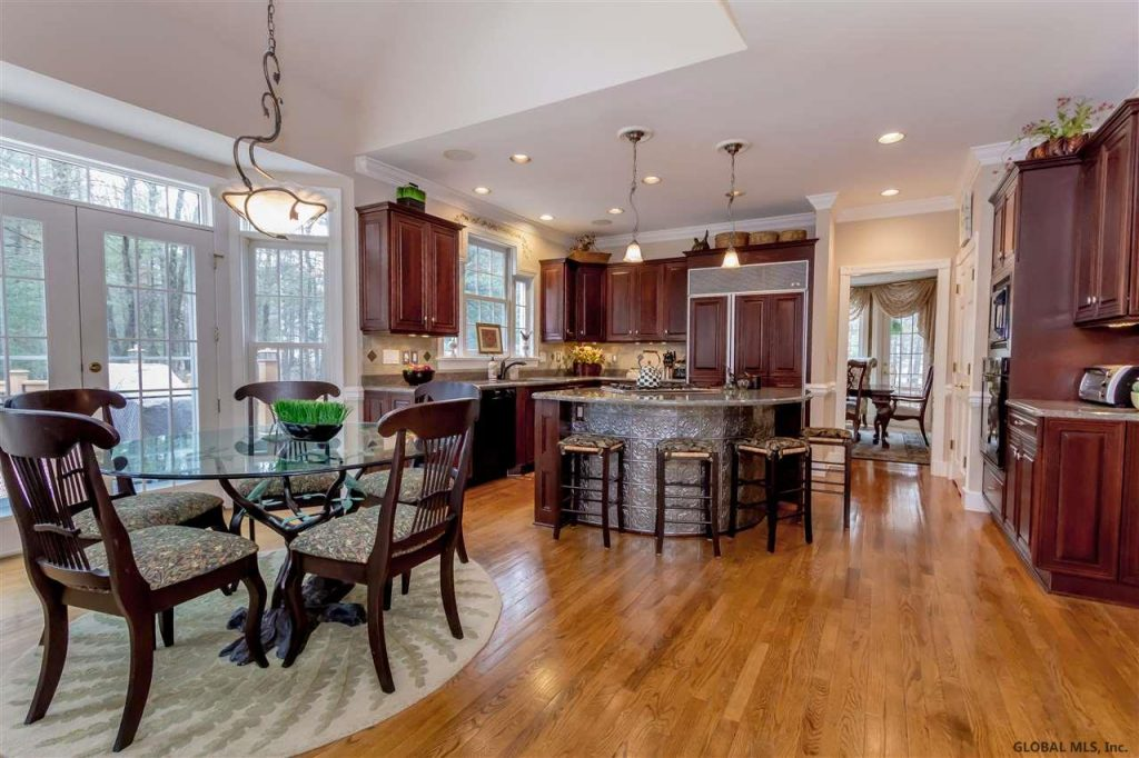 2 Rolling Brook Drive, Saratoga Springs, NY is a home for sale with a beautiful gourmet kitchen with Sub-Zero fridge and island cooktop.