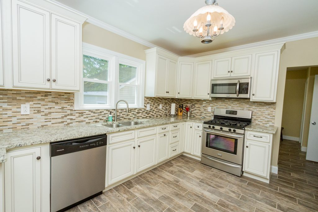1 Van Dorn Street is a home in Saratoga Springs with a beautiful kitchen with new stainless steel appliances, granite countertops, solid wood cabinets, new flooring and backsplash.