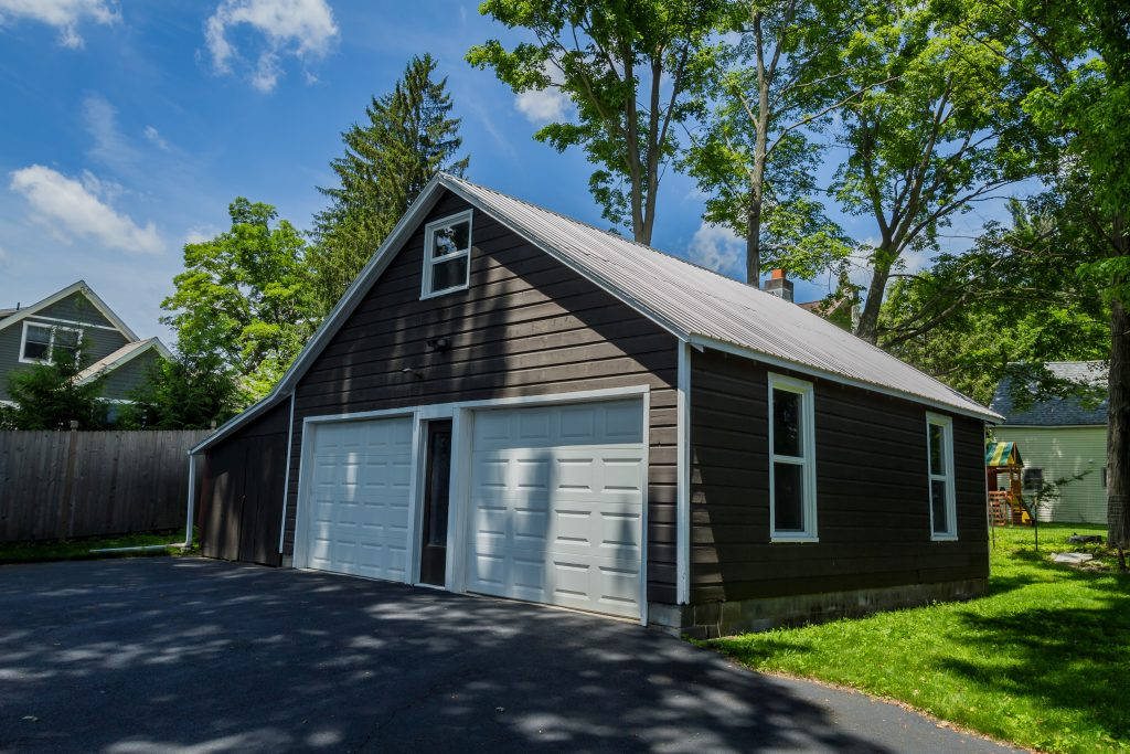 1 Van Dorn Street is a home in Saratoga Springs with a over sized garage has an attached shed that is large enough to park an additional car.