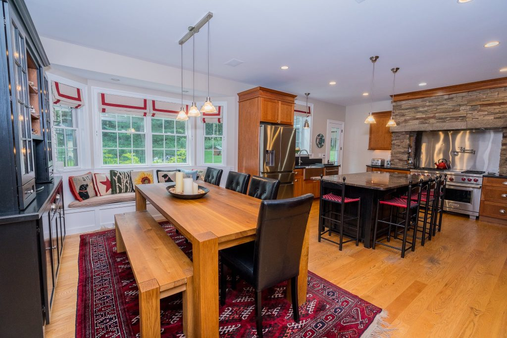 16 Beacon Hill Drive is a home for sale in saratoga springs new york with a cherry kitchen featuring commercial grade appliances, built ins and eat in area