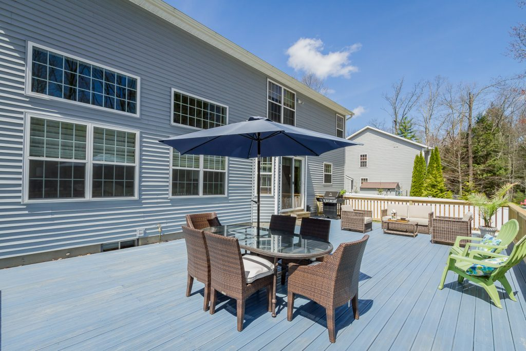 8 Overlook is a home for sale in Wilton, NY with a large back deck great for entertaining and plenty of space for guests.