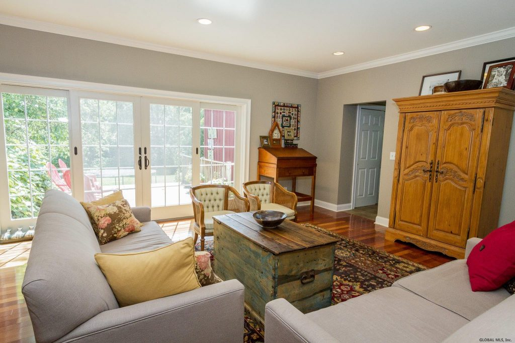 288 Riverview Road is a home for sale in Rexford, NY with a lovely large living room with Brazilian cherry floors.