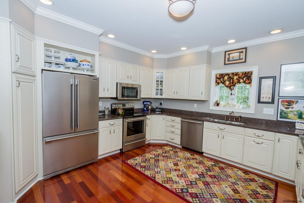 288 Riverview Road is a home for sale in Rexford, NY with a Beautiful built-ins and white kitchen cabinetry with gorgeous granite.