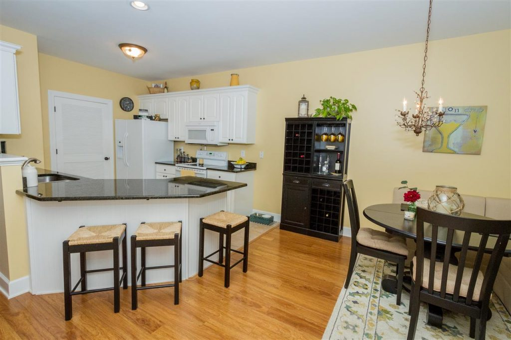 324 Ballston Avenue is a home for sale in Saratoga Springs, NY with a Beautiful white kitchen, plenty of cabinetry, crown molding, new sink & faucet & wonderful granite counter-tops with breakfast bar to sit at.