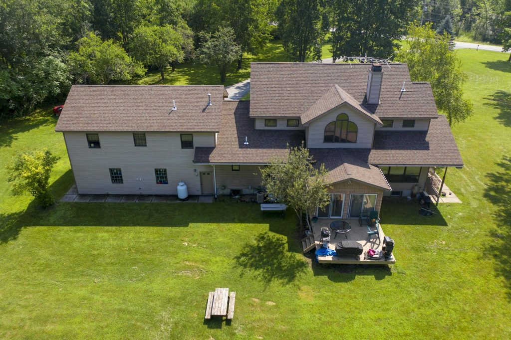 2187 Rowley Road has a large back yard with access to a raised wooden deck.