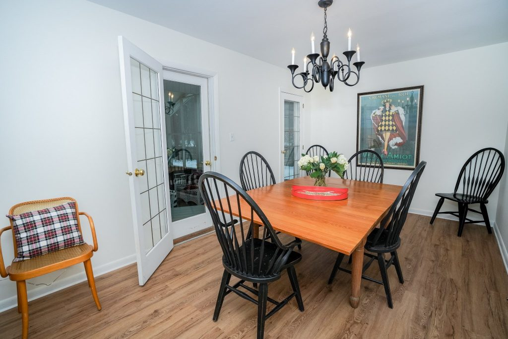 33 Rip Van Lane is a home for sale in Saratoga Springs, NY with a dining room with direct access to the screened-in porch.