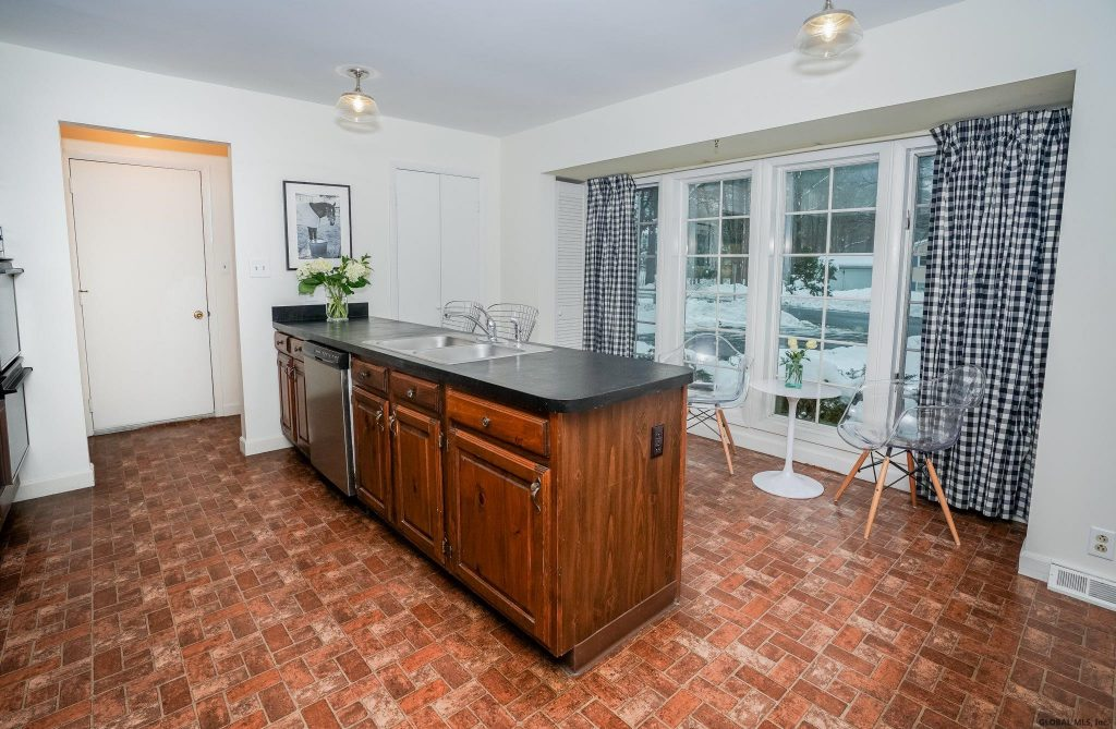 33 Rip Van Lane is a home for sale in Saratoga Springs, NY with a kitchen with center breakfast bar & table space and laundry room off of kitchen.