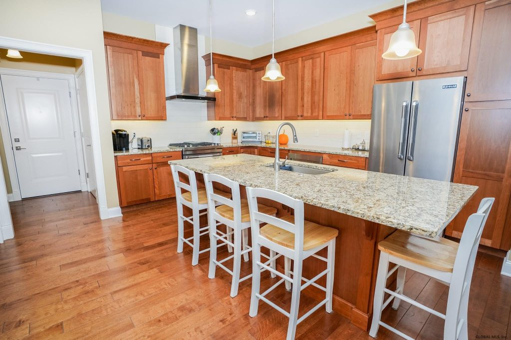 46 Union Avenue is a condo for sale in Saratoga Springs, NY with an eat-in kitchen with gorgeous cherry cabinetry, granite counter-tops, pantry and a huge island.