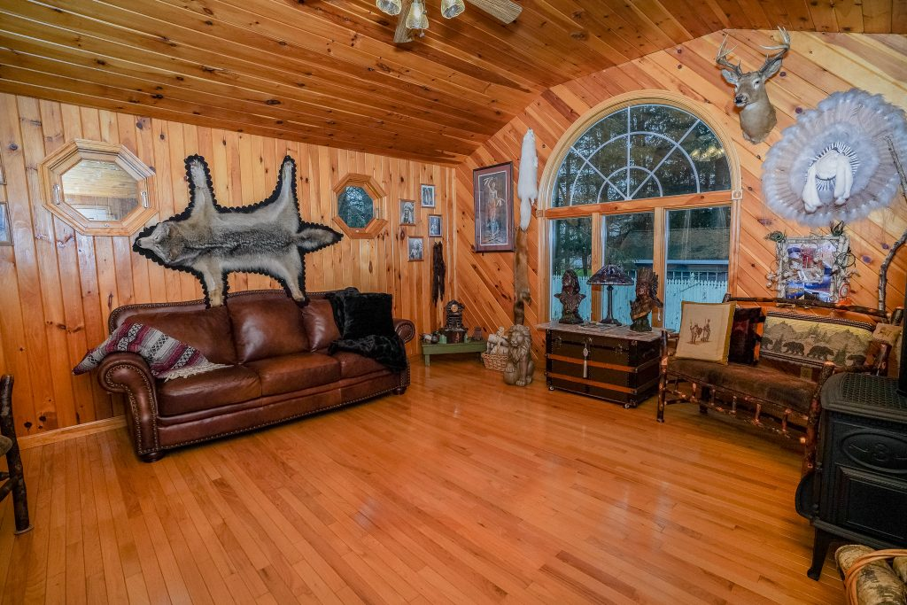 19 Crommelin Drive is a home for sale in Saratoga Springs, NY with an Adirondack room overlooking the great backyard, with a gas fireplace for the colder months.