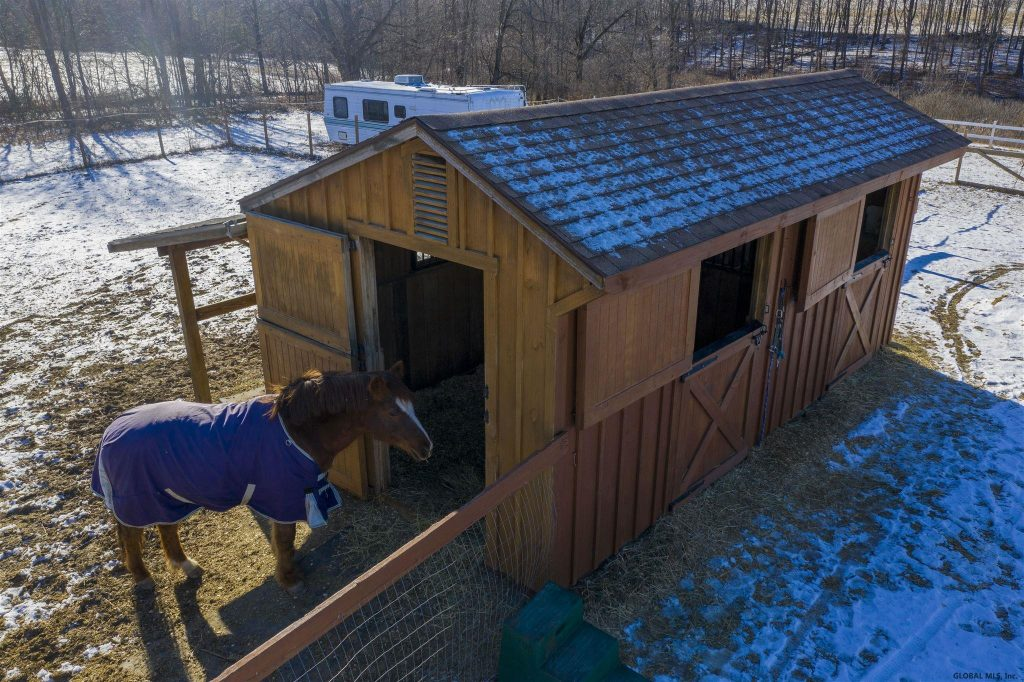 169 Gronczniak Road is a home for sale in Stillwater, NY with a two-stall barn and a large fenced in area for grazing.