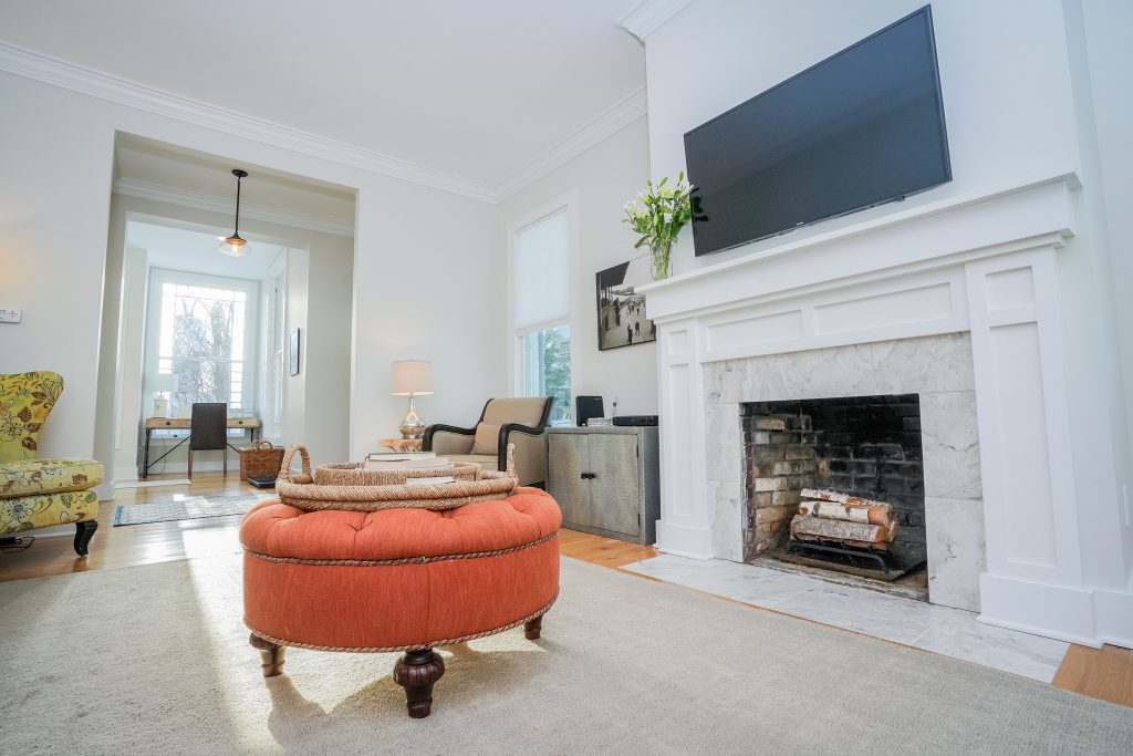 2 North Circular Street is a home for sale in Saratoga Springs, NY with a spacious family room with a wood burning fireplace