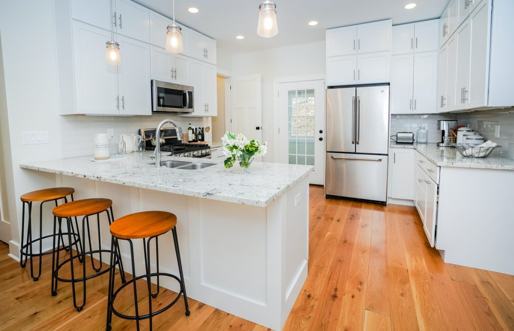 2 North Circular Street is a home for sale in Saratoga Springs, NY with a modern granite and subway-tiled eat-in kitchen