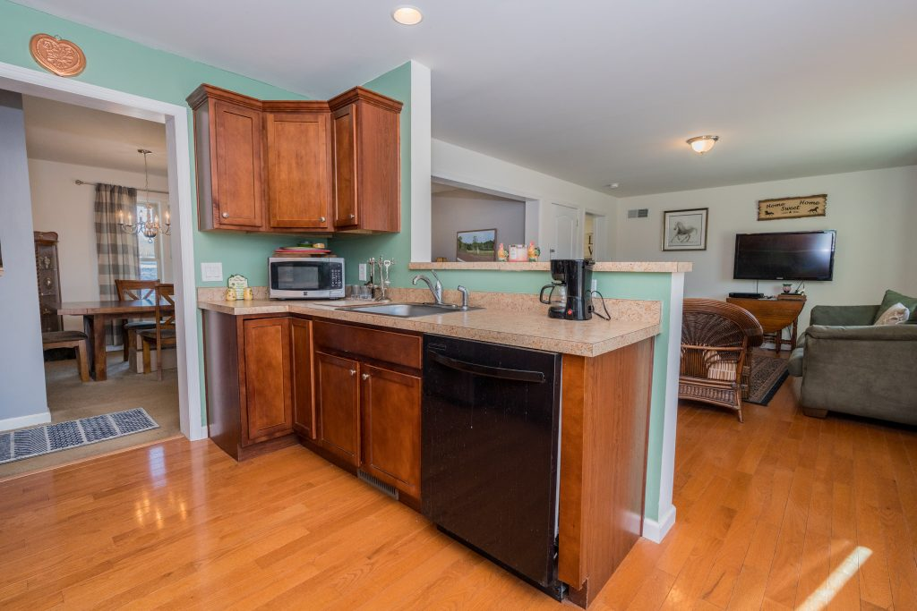 169 Gronczniak Road is a home for sale in Stillwater, NY with an open living and dining area perfect for entertaining