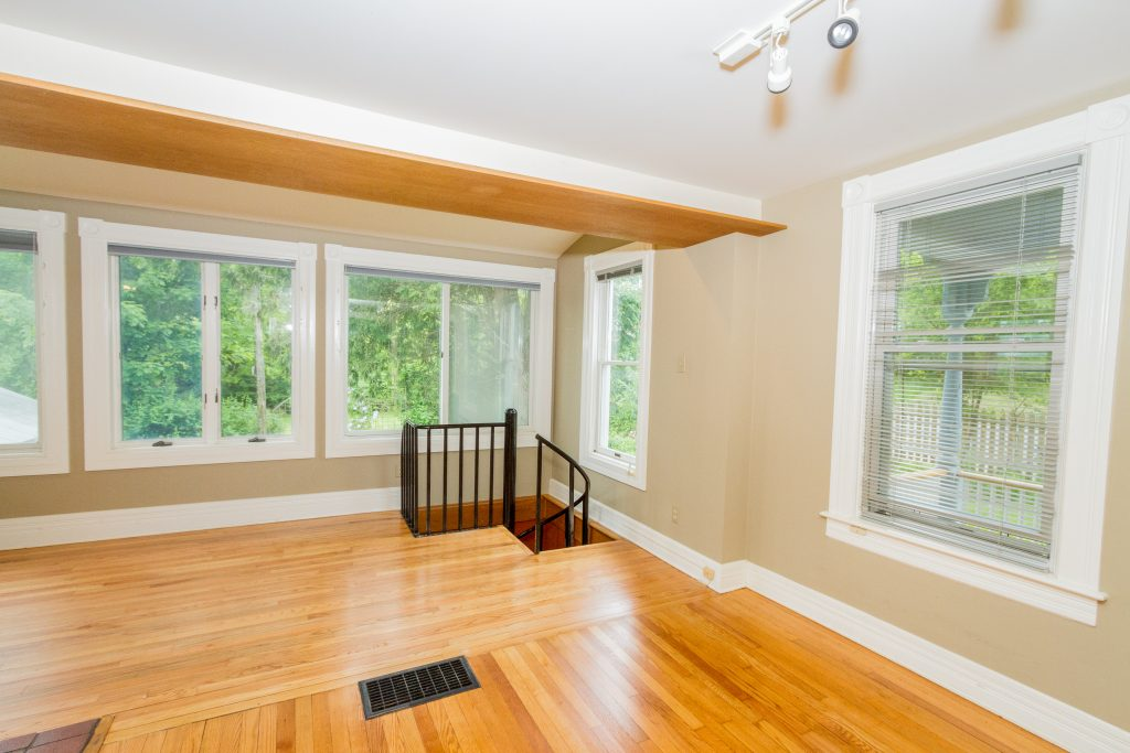 240 Broad Street is a home for sale in Schuylerville, NY with a spiral staircase leading to the main floor.