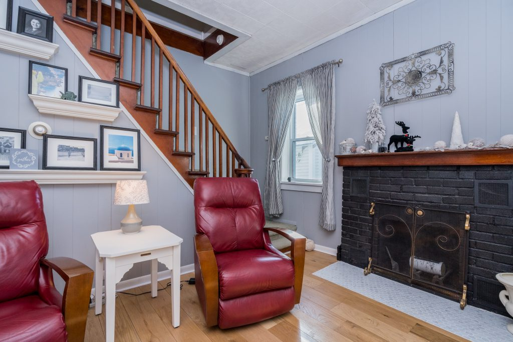 162 is a home for sale in Saratoga Springs, NY with a full masonry wood burning fireplace in the living room