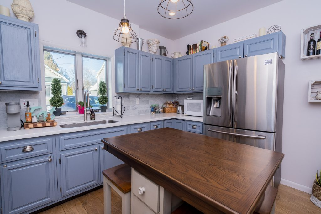 162 Ash Street is a home for sale in Saratoga Springs with solid surface counters with a marble backsplash and LED recessed lighting