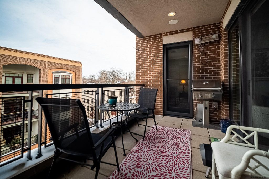 37 Henry Street is a home for sale in Saratoga Springs, NY with a large balcony with new gas grill and outdoor heater