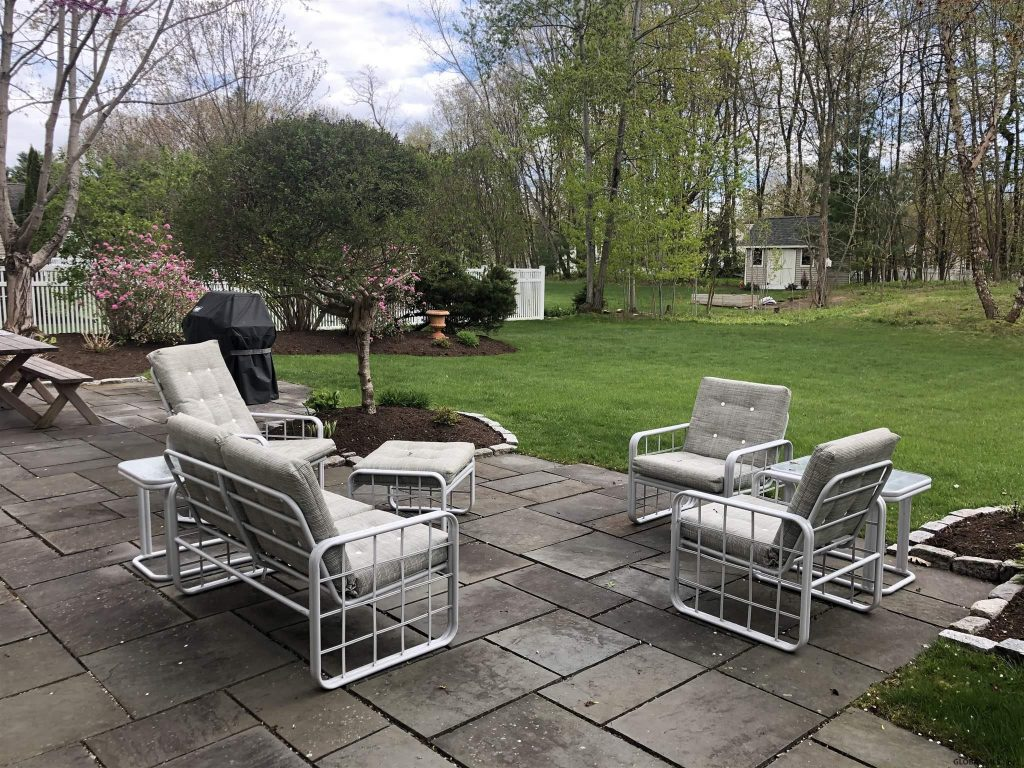 54 Waterview Drive is a home for sale in Saratoga Springs, NY 12866 with a stone patio in a private rear yard
