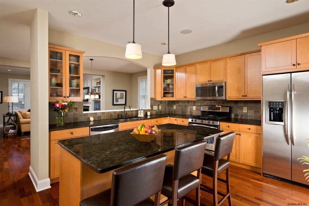 30 Whistler Court, Unit #411 is a town-home for sale in Saratoga Springs, NY with a gourmet kitchen features stainless steel appliances, granite counter tops, a huge walk-in pantry