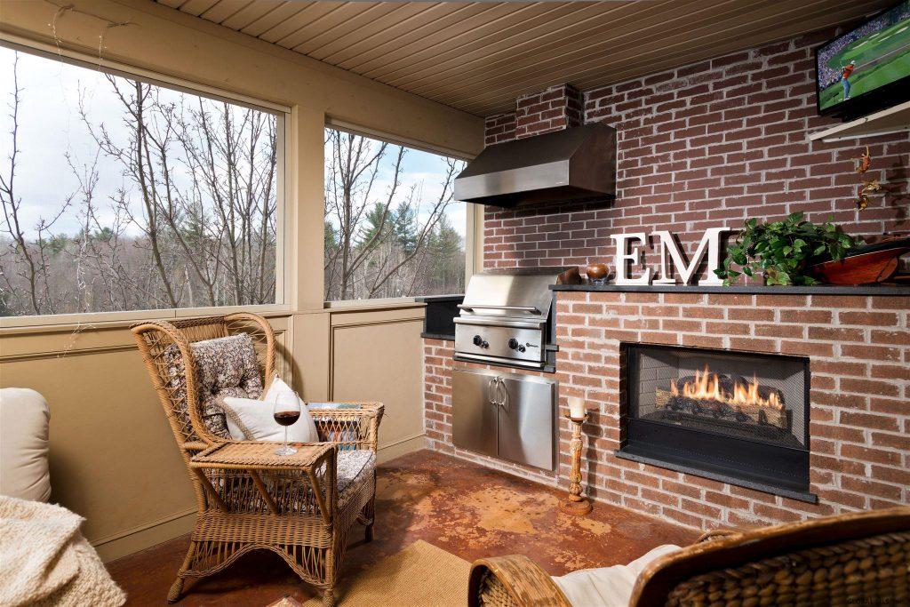30 Whistler Court, Unit #411 is a town-home for sale in Saratoga Springs, NY with a screened porch with fireplace and built in gas grill overlooking nature