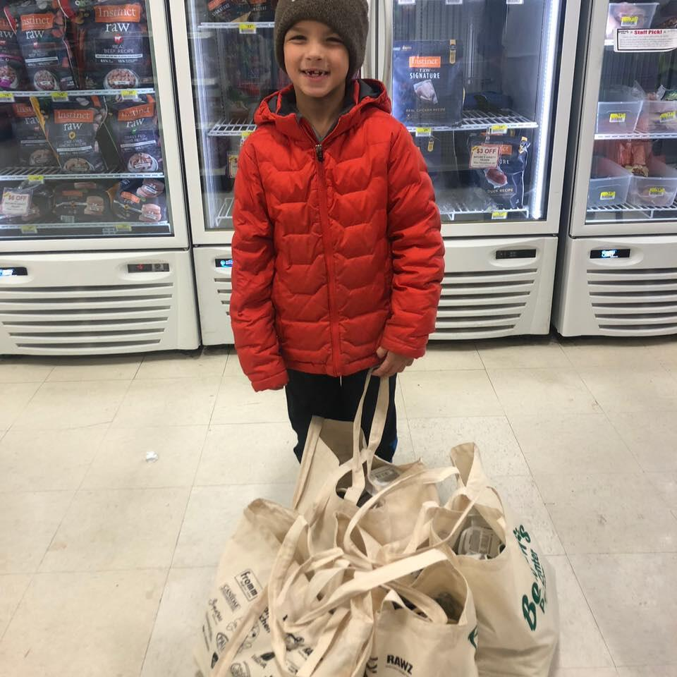 Chase Lewis of Wilton, NY getting Thanksgiving donations from Benson's Pet Center for animal shelters