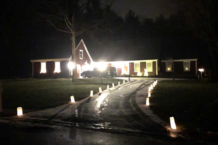 Terry Nawrot of Ganesvoort lines her driveway with luminaries from SNACpack's 2020 holiday fundraiser