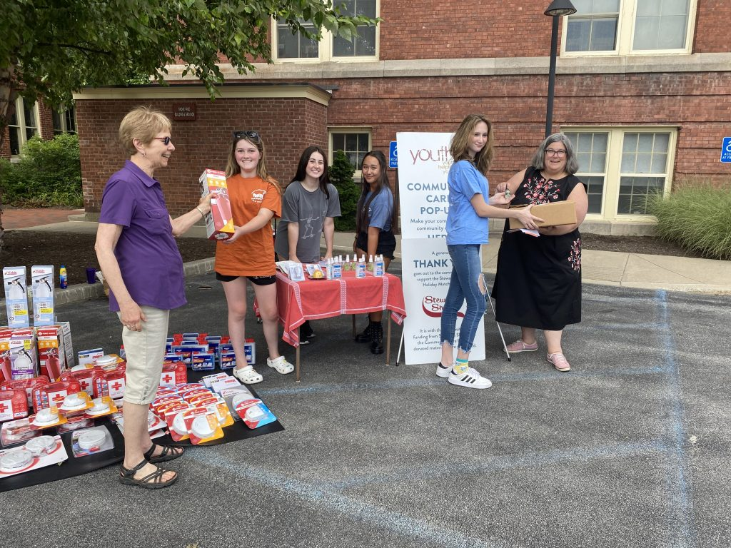 Audrey Belt (left) and Assemblywoman Carrie Woerner (right) drop off donations for Youth2's Emergency and Safety Kit pop-up event. Youths (from left to right): Kenzie Hamelin, Avery, Olivia Venditti, Ella Daley.